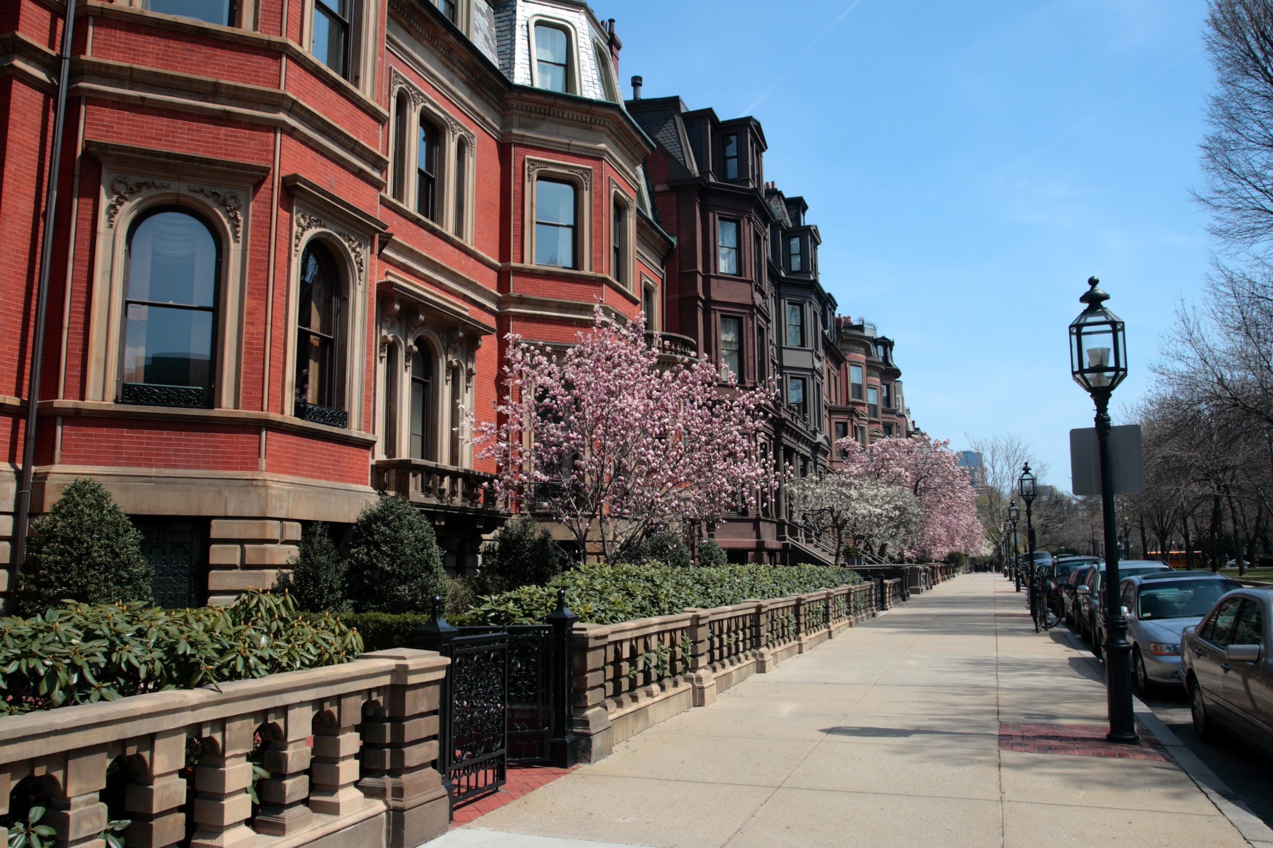 Sprawling row of traditional residential brownstones in Beacon Hill Boston, Massachusetts.